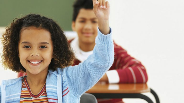 yowoto-child-in-classroom-with-hand-up