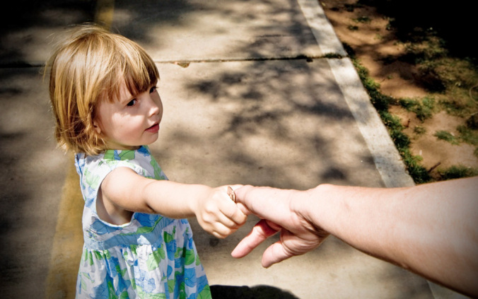 little-girl-grabs-adult-hand