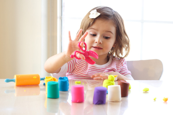 toddler-girl-with-playdough_rdwngs